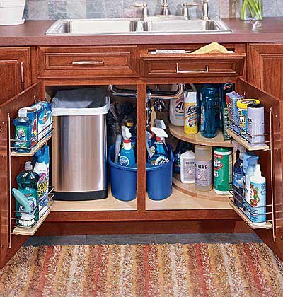 Tilting drawers, door racks, and stacking shelves can help maximize storage under the sink.