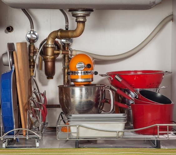 Pots, pans, and a mixer under sink
