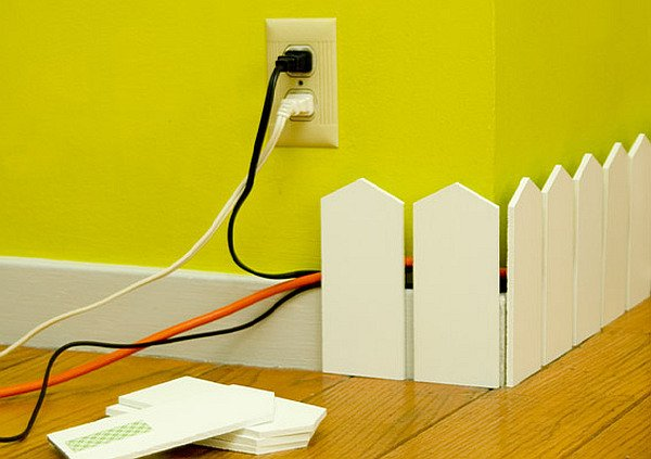 wall white fence pieces to hide cords and wires How to Deal with Cables and Wires
