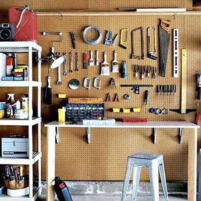 garage organization - pegboard wall - panels about $16 each at lowe's for 4x8 foot.